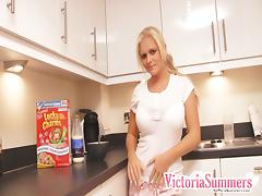 Slutty solo model with big tits undresses in the kitchen