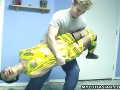 Skinny brunette Asian gets wrapped in plastic and toyed