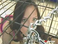 Releasing his brunette slave from his cage to destroy her cunt