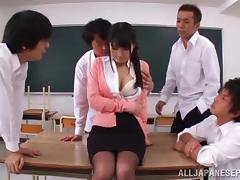 Gangbanging an attractive Japanese school teacher in pantyhose