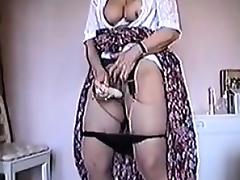 Granny Masturbates With Her Vibrator