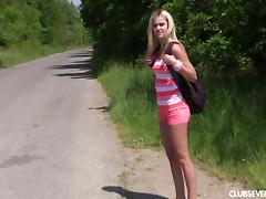 Teen blonde hitchhiker takes a break and fingers her pussy