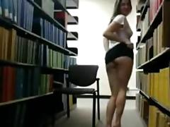 Solo girl shows tits in library