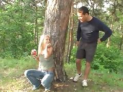 Jeans-clad blonde with beautiful natural tits enjoying a hardcore fuck in a forest