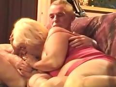 Grandma sucks grandpa's cock, while he watches tv.