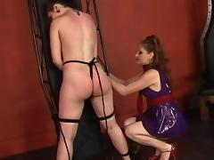 Hot young lesbian restrains her slave girl and whips and spanks her ass