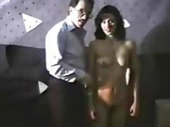 Sexy hottie with a unshaved cunt sucks strapon.