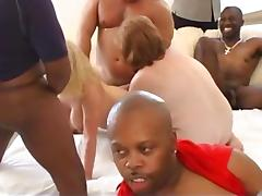 Wild interracial orgy with Milfs