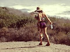 Beach babe in a bikini sucks her man's cock and fucks doggystyle