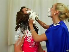 Euro girls empty cans of shaving cream on each other