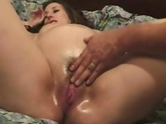 Young pregnant chick gets oiled up, pussy rubbed, then returns the favor