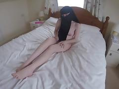Wife in niqab uses a toy to pleasure herself playing with her tits and pussy