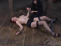 Redhead with a cute face and a special torture for her tits