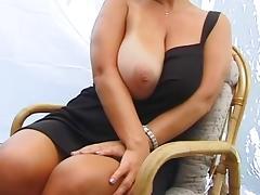 Cute MILF shows her big tits