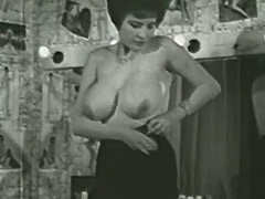 Busty Mature Lady Follows the Undressing Directions 1950