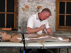 Handjob for bound boy in plastic wrap