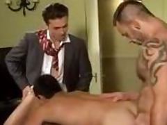 Gay in a suit gets fucked in his mouth and ass by two other guys