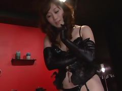 Sexy Japanese girl in latex costume gives a blowjob