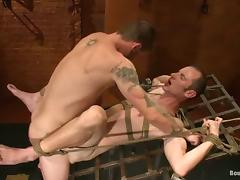Brenn is crossed and blindfolded for gay BDSM