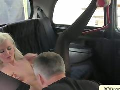 Blonde in stockings in fake taxi fucks hard