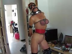 Redhead in chains plays with a big dildo