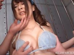 Handcuffed Japanese Satomi Nagase gets her cunt toyed by two men